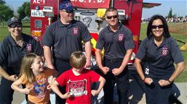 Firefighters and little kids