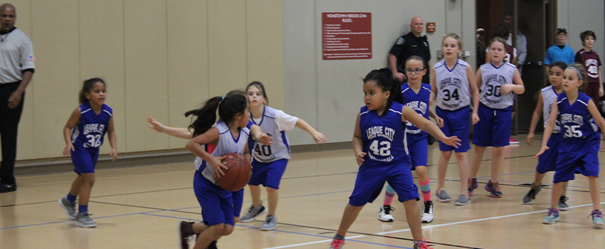 Girls playing in basketball tournament
