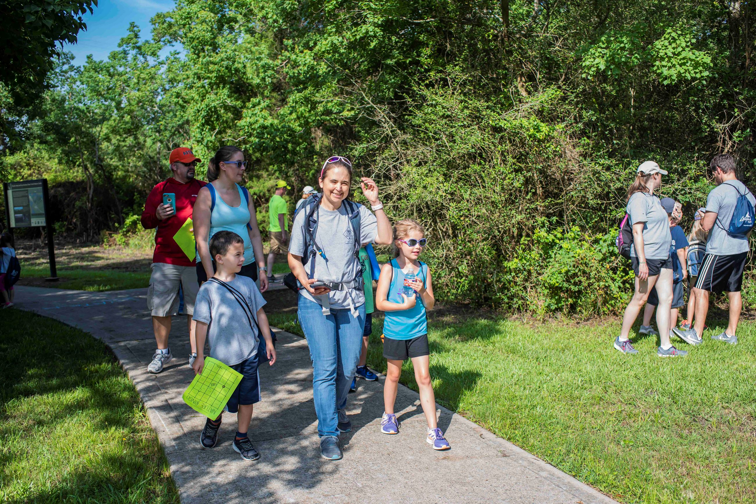 families walking along a trail in a nature center